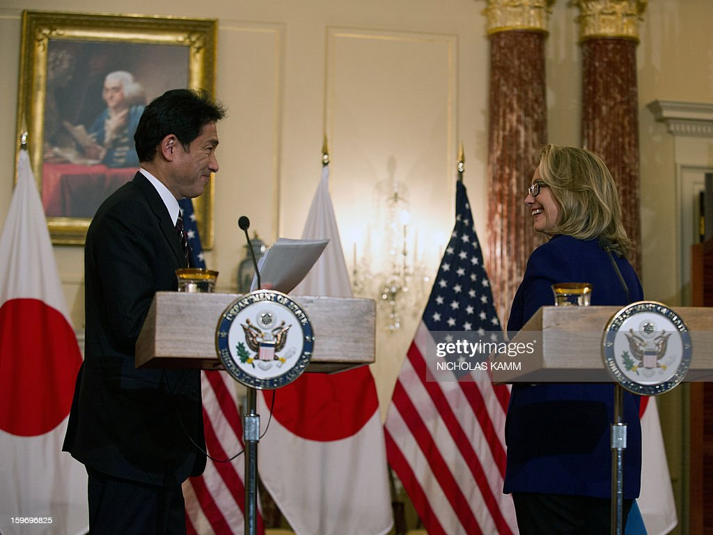US Secretary of State Hillary Clinton and Japanese Foreign Minister Fumio Kishida smile at each other after speaking to the press following talks at the State Department in Washington,DC on January 18, 2013. AFP PHOTO/Nicholas KAMM