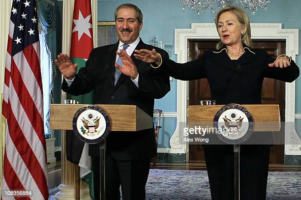 S Secretary of State Hillary Clinton and Jordanian Foreign Minister Nasser Judeh speak during a joint press availability January 26 2011 at the State...