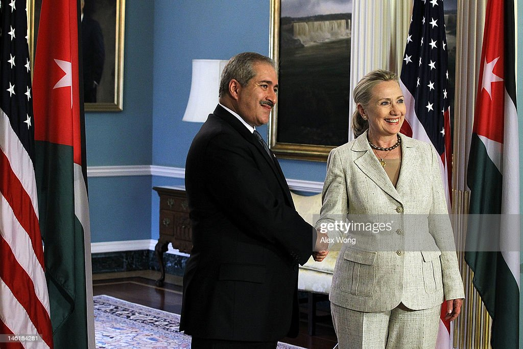 U.S. Secretary of State Hillary Clinton (R) and Jordanian Foreign Minister Nasser Judeh (L) shake hands after they spoke to the media prior to their meeting at the State Department June 11, 2012 in Washington, DC. Clinton met with Judeh to discuss topics including bilateral developments and the crisis in Syria.
