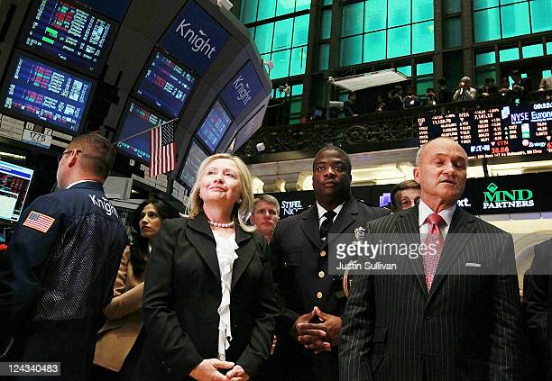 S Secretary of State Hillary Clinton and New York City Police Commissioner Ray Kelly walk on the floor of the New York Stock Exchange after the...