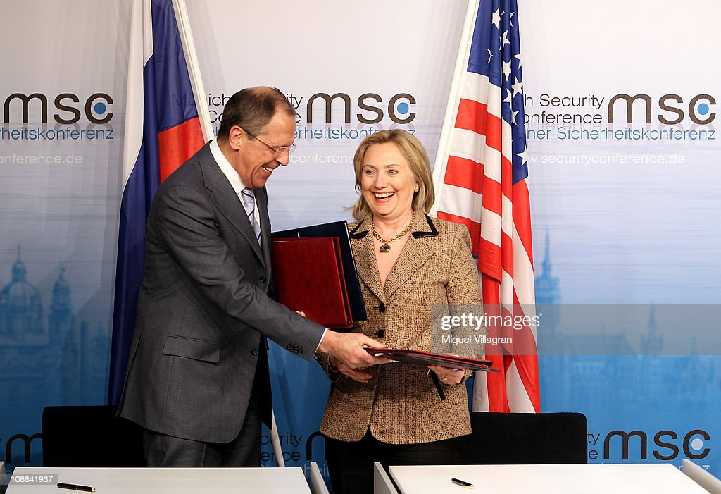 US Secretary of State <a gi-track='captionPersonalityLinkClicked' href=/galleries/search?phrase=Hillary+Clinton&family=editorial&specificpeople=76480 ng-click='$event.stopPropagation()'>Hillary Clinton</a> and Russian Foreign Minister Sergei Lavrov exchange documents formally bringing into force the landmark nuclear arms reduction pact START during the second day of the 47th Munich Security Conference at Hotel Bayerischer Hof on February 5, 2011 in Munich, Germany. The 47th Munich conference on security policy is running till February 6, 2011.