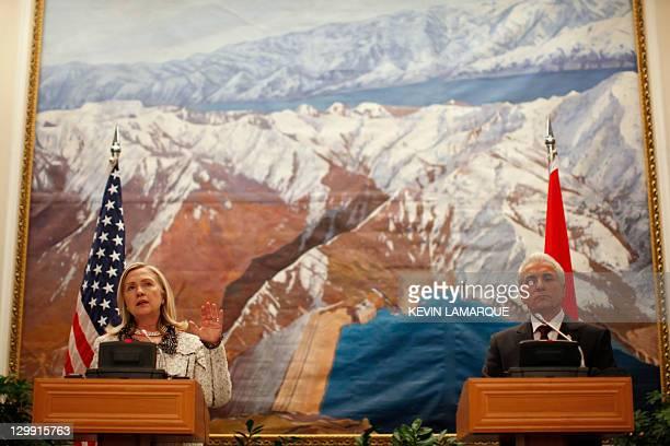 US Secretary of State Hillary Clinton and Tajik Prime Minister Tajik Foreign Minister Hamrokhon Zarifi give a press conference on October 22 2011...