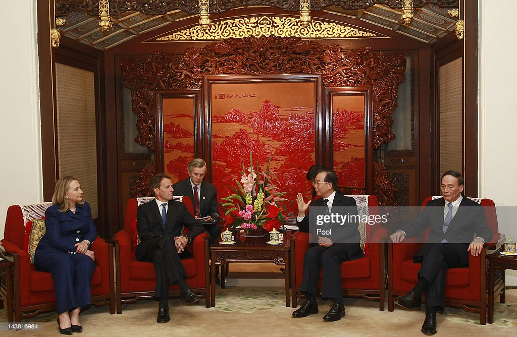 U.S. Secretary of State Hillary Clinton (L) and Treasury Secretary Timothy Geithner (2nd L) talk to China's Premier Wen Jiabao (2nd R) and Vice Premier Wang Qishan (R) during a meeting at the Zhongnanhai leadership compound on May 4, 2012 in Beijing. Hillary Clinton is in China for bilateral talks and has called on China to protect human rights. Chinese activist Chen Guangcheng has aksed to meet with the U.S Secretary of State to discuss his situation.