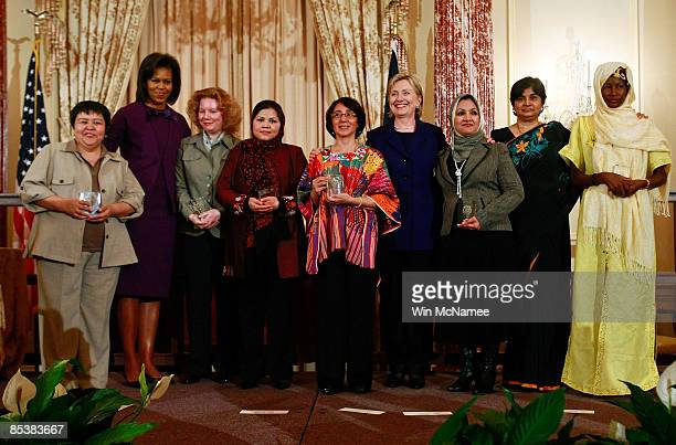 Secretary of State Hillary Clinton and US first lady Michelle Obama pose for a photo with recipients at an awards ceremony to announce this year's...