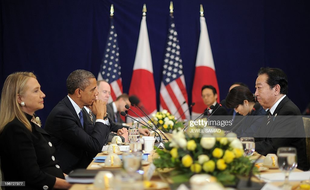 US Secretary of State Hillary Clinton (L) and US President Barack Obama (2nd L) listen to Japanese Prime Minister Yoshihiko Noda (R) speak during their bilateral meeting on the sidelines of the East Asian Summit at the Peace Palace in Phnom Penh on November 20, 2012. During the two-day East Asia Summit in Phnom Penh, Obama was scheduled to hold talks with the leaders of the 10-member Association of Southeast Asian Nations (ASEAN) along with Chinese Premier Wen Jiabao and Japan's Yoshihiko Noda. AFP PHOTO / Jewel Samad