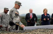 US Secretary of State Hillary Clinton and US Secretary of Defense Robert Gates are briefed at a South Korea Guide Post near Panmunjom in the...