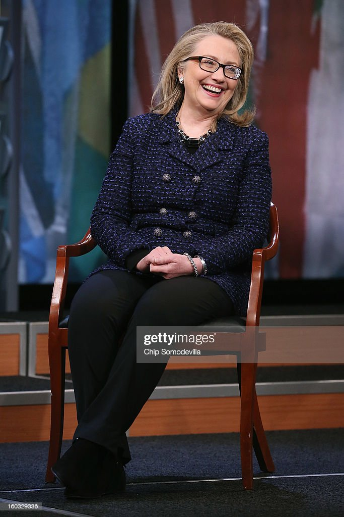 U.S. Secretary of State Hillary Clinton answers questions from people from around the world during a 'Global Townterview' at the Newseum January 29, 2013 in Washington, DC. Clinton took questions from youths from around the world via satellite and social media including Twitter, Facebook and Skype in advance of her last day at the State Department Friday.