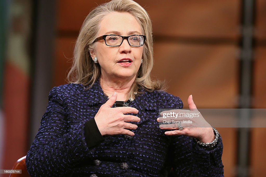 U.S. Secretary of State <a gi-track='captionPersonalityLinkClicked' href=/galleries/search?phrase=Hillary+Clinton&family=editorial&specificpeople=76480 ng-click='$event.stopPropagation()'>Hillary Clinton</a> answers questions from students from around the world during a 'Global Townterview' at the Newseum January 29, 2013 in Washington, DC. Clinton took questions from an international group of youths via satellite and social media including Twitter, Facebook and Skype in advance of her last day at the State Department Friday.