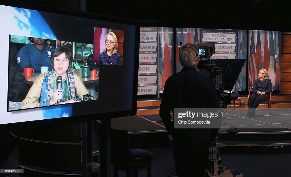 U.S. Secretary of State Hillary Clinton appears on a television screen as she talks with NDTV's Barkha Dutt during a 'Global Townterview' at the Newseum January 29, 2013 in Washington, DC. Clinton took questions from an international group of youths via satellite and social media including Twitter, Facebook and Skype in advance of her last day at the State Department Friday.