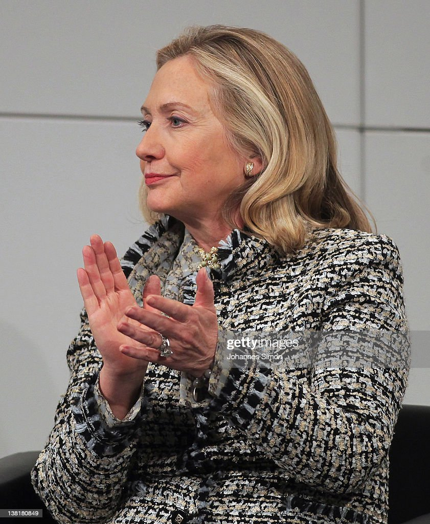 US Secretary of State <a gi-track='captionPersonalityLinkClicked' href=/galleries/search?phrase=Hillary+Clinton&family=editorial&specificpeople=76480 ng-click='$event.stopPropagation()'>Hillary Clinton</a> applauds during a panel talk on day 2 of the 48th Munich Security Conference at Hotel Bayerischer Hof on February 4, 2012 in Munich, Germany. The 48th Munich conference on security policy is running until February 5, 2012.