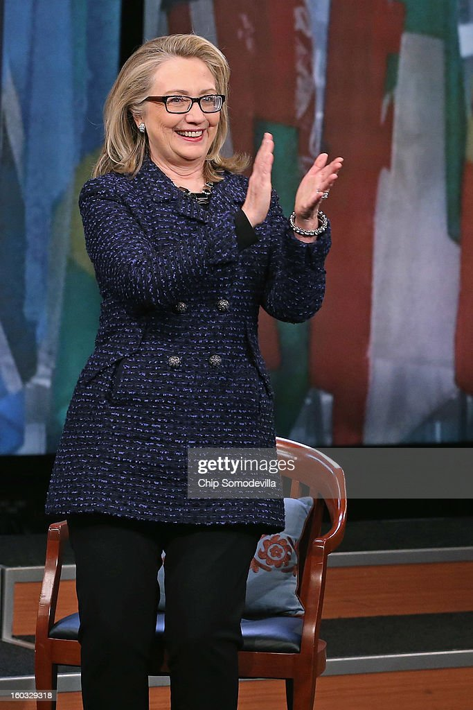 U.S. Secretary of State <a gi-track='captionPersonalityLinkClicked' href=/galleries/search?phrase=Hillary+Clinton&family=editorial&specificpeople=76480 ng-click='$event.stopPropagation()'>Hillary Clinton</a> applauds for her audience after a 'Global Townterview' at the Newseum January 29, 2013 in Washington, DC. Clinton took questions from youths from around the world via satellite and social media including Twitter, Facebook and Skype in advance of her last day at the State Department Friday.