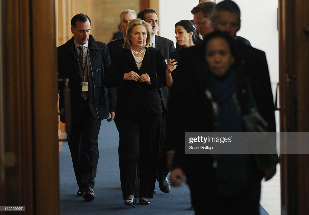 U.S. Secretary of State Hillary Clinton (C) arrives for talks with German Foreign Minister Guido Westerwelle at an informal meeting of NATO member foreign ministers on April 15, 2011 in Berlin, Germany. The principal focus of the two-day meeting is the alliance's military involvement in the war in Libya, though it also includes special roundtables on the alliance's relationship to Russia, Ukraine and Georgia.