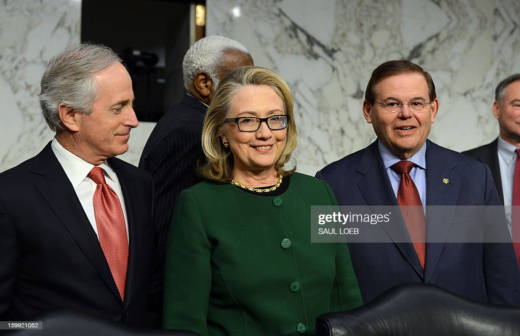 US Secretary of State Hillary Clinton arrives to testify before the Senate Foreign Relations Committee on the September 11, 2012 attack on the US mission in Benghazi, Libya, during a hearing on Capitol Hill in Washington, DC, on January 23, 2013. Looking on are US Sen. Robert Menendez(R) D-NJ and US Sen. Bob Corker (R-TN). AFP PHOTO / Saul LOEB