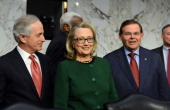 US Secretary of State Hillary Clinton arrives to testify before the Senate Foreign Relations Committee on the September 11 2012 attack on the US...