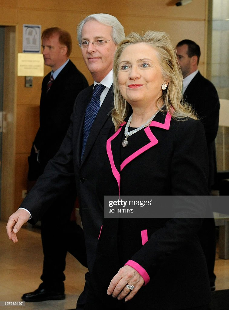 US Secretary of State Hillary Clinton (R) arrives with US NATO Ambassador Ivo Daalder on December 4, 2012 at North Atlantic Treaty Organization (NATO) headquarters in Brussels for a meeting of foreign ministers from the 28 NATO member-countries to discuss Syria and Turkey's request for Patriot missiles to be deployed protectively on the Turkish-Syrian border. AFP PHOTO / JOHN THYS