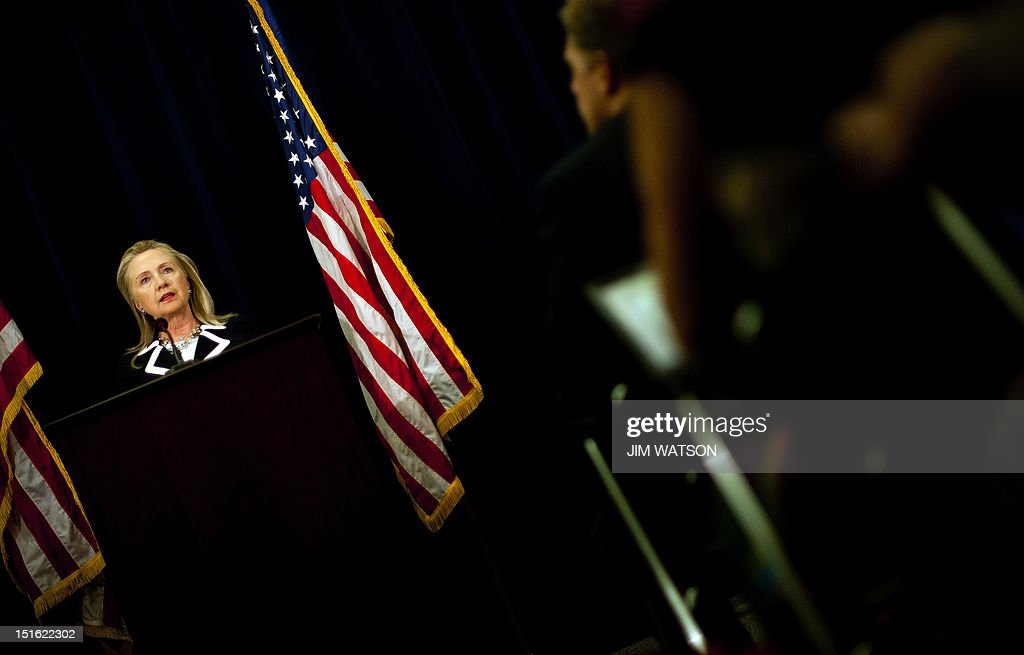 US Secretary of State Hillary Clinton (L) delivers remarks during a press conference at the US consulate in Vladivostok on September 9, 2012 after taking part in the Asia-Pacific Economic Cooperation (APEC) summit. Clinton on September urged US allies South Korea and Japan to 'lower the temperature' in a simmering territorial row. AFP PHOTO/POOL/Jim WATSON