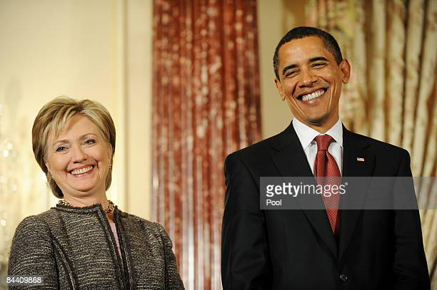 S Secretary of State Hillary Clinton during her first full day on the job stands next to President Barack Obama at the State Department's...