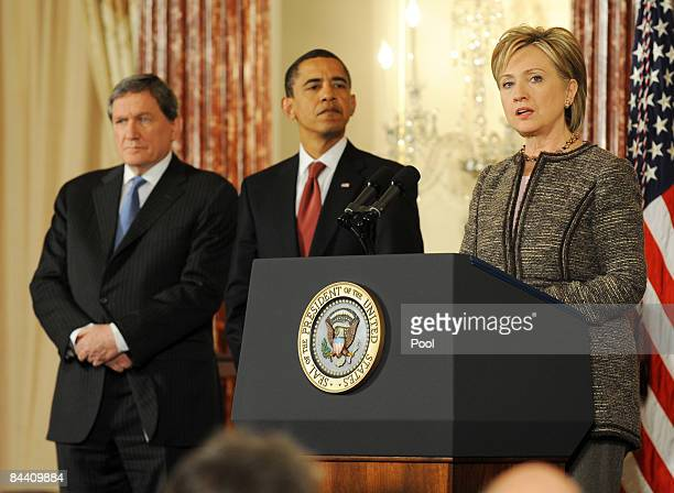 S Secretary of State Hillary Clinton during her first full day on the job speaks as President Barack Obama and former Ambassador Richard Holbrook...
