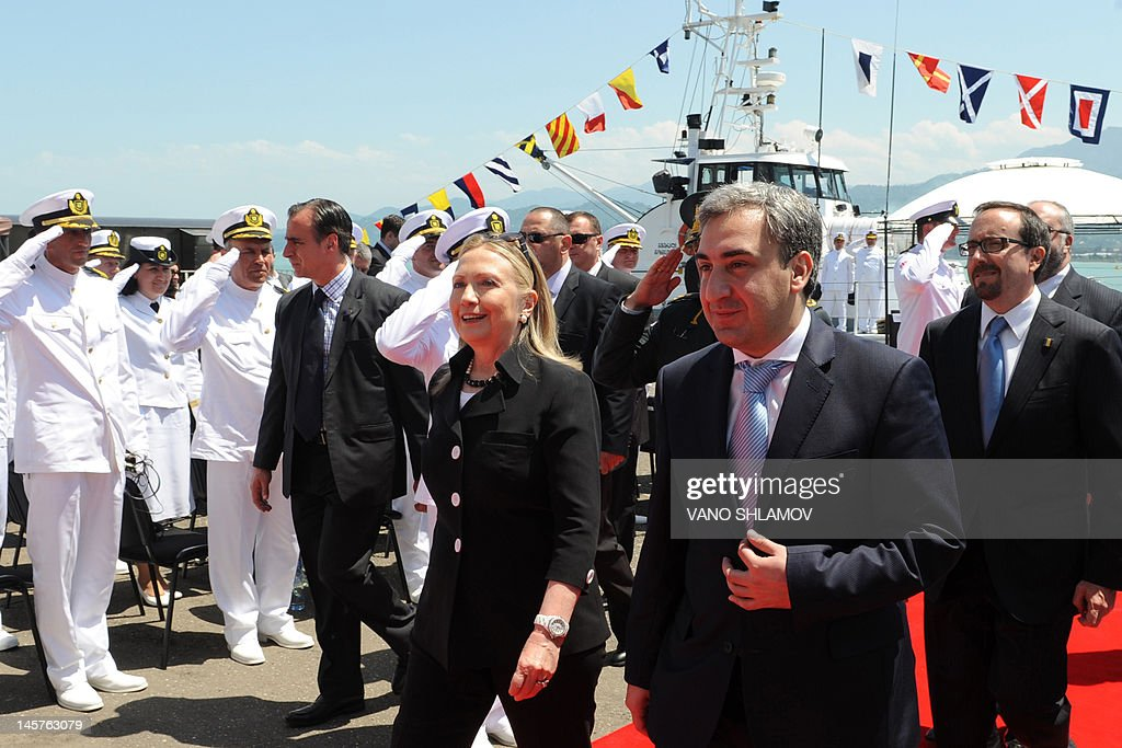 US Secretary of State Hillary Clinton (C), Georgian Prime Minister Nika Gilauri (2nd R) and US Ambassador to Georgia John Bass (R) walk after attending a Coast Guard ship commissioning ceremony at the passenger terminal wharf in the Georgia's Black Sea port of Batumi, on June 5, 2012. The Soviet-designed boat, which will patrol the eastern end of the Black Sea, was commissioned into the Georgian Coast Guard after a refurbishment with the latest technology, using funds provided by the US State Department Export Border Control and Related Security Program.