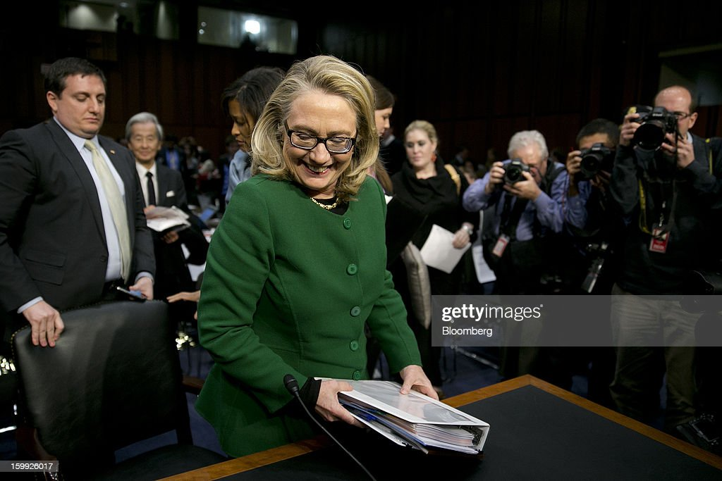 U.S. Secretary of State <a gi-track='captionPersonalityLinkClicked' href=/galleries/search?phrase=Hillary+Clinton&family=editorial&specificpeople=76480 ng-click='$event.stopPropagation()'>Hillary Clinton</a> gets out of her seat following a Senate Foreign Relations Committee hearing in Washington, D.C., U.S., on Wednesday, Jan. 23, 2013. Clinton said she is moving quickly to correct the kinds of lapses in diplomatic security that left American diplomats vulnerable in the September attack on the U.S. mission in Benghazi, Libya. Photographer: Andrew Harrer/Bloomberg via Getty Images