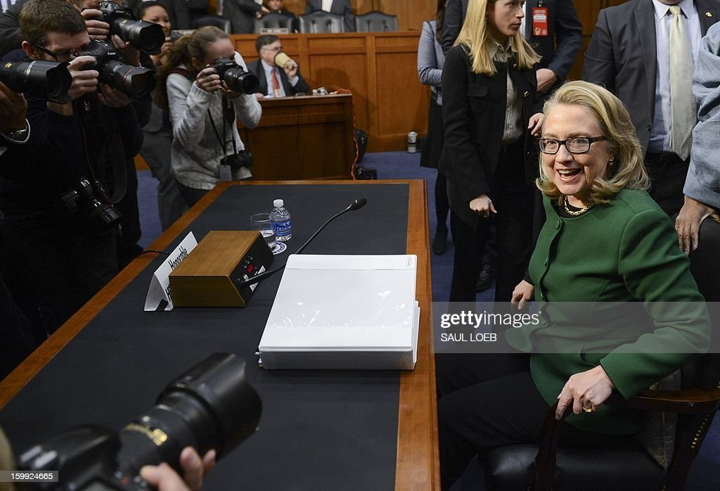 US Secretary of State Hillary Clinton gets ready to leave after testifying before the Senate Foreign Relations Committee on the September 11, 2012 attack on the US mission in Benghazi, Libya, during a hearing on Capitol Hill in Washington, DC, on January 23, 2013. US Secretary of State Hillary Clinton on Wednesday warned of rising militancy in the wake of the Arab Spring, in an emotional and at times heated testimony into the deadly Benghazi attack.'Benghazi didn't happen in a vacuum,' Clinton said at the start of a Senate hearing into the September 11 assault on a US mission in eastern Libya. 'The Arab revolutions have scrambled power dynamics and shattered security forces across the region,' she told the Foreign Relations committee called to review the lessons learned from the attack, in which US ambassador Chris Stevens and three other Americans were killed.AFP PHOTO / Saul LOEB