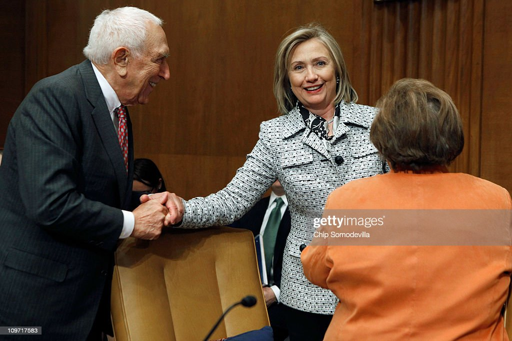 Secretary of State Hillary Clinton (C) greets Senate Appropriations Subcommittee on State, Foreign Operations, and Related Programs members Sen. Frank Lautenberg (D-NJ) (L) and Sen. Barbara Mikulski (D-MD) before testifying about the department's FY2012 budget on Capitol Hill March 2, 2011 in Washington, DC. Clinton reminded senators that civilians from the State Department will need appropriate budget increases so to take over the U.S. mission in Iraq after the Department of Defense pulls out the last troops at the end of 2011.
