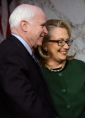 US Secretary of State Hillary Clinton greets US Senator John MCCain before she testifies before the Senate Foreign Relations Committee on the...