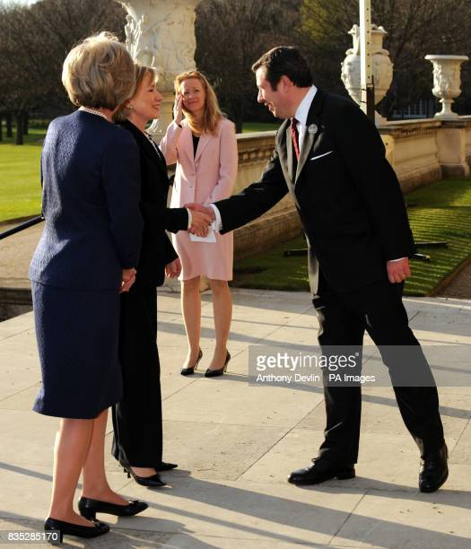 US Secretary of State Hillary Clinton is greeted by Edward Young Deputy Private Secretary to the Queen as she arrives at Buckingham Palace London...