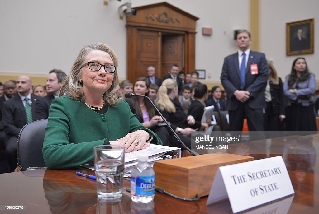 US Secretary of State Hillary Clinton is seated before testifying before the House Foreign Affairs Committee on the September 11, 2012 attack on the US mission in Benghazi, Libya in the Rayburn House Office Building on January 23, 2013 in Washington, DC. AFP PHOTO/Mandel NGAN