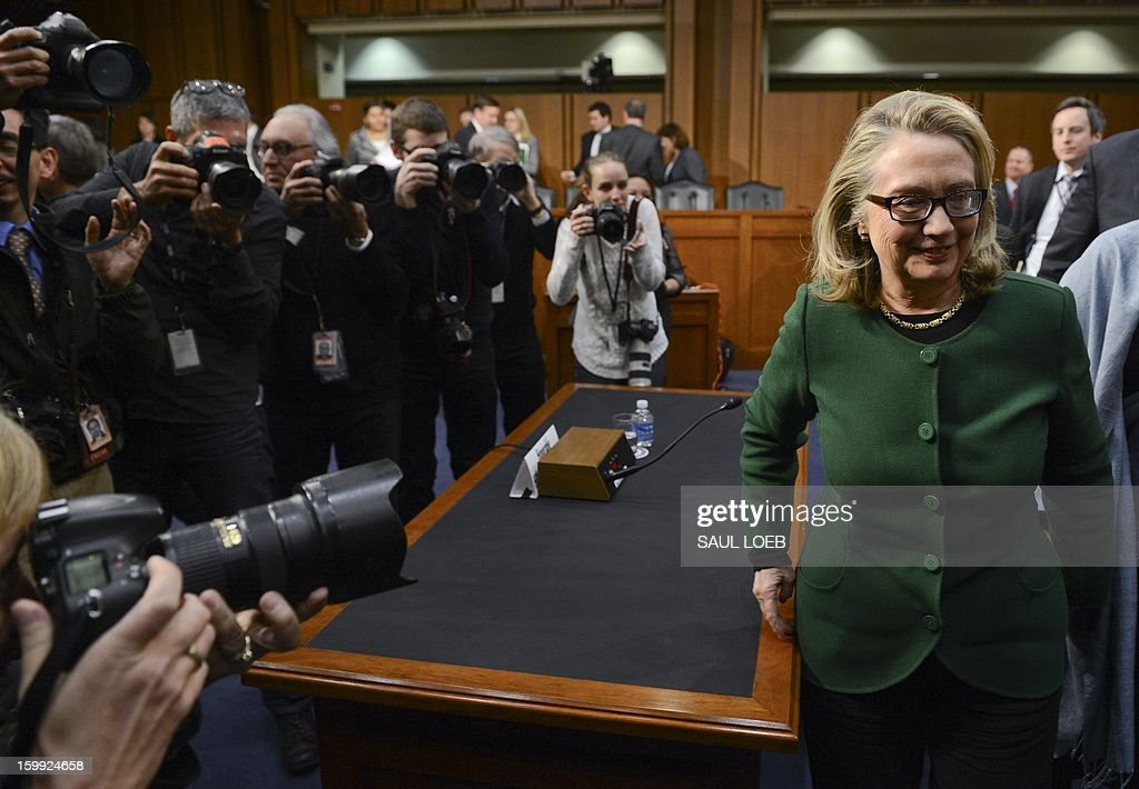 US Secretary of State Hillary Clinton leaves after testifying before the Senate Foreign Relations Committee on the September 11, 2012 attack on the US mission in Benghazi, Libya, during a hearing on Capitol Hill in Washington, DC, on January 23, 2013. US Secretary of State Hillary Clinton on Wednesday warned of rising militancy in the wake of the Arab Spring, in an emotional and at times heated testimony into the deadly Benghazi attack.'Benghazi didn't happen in a vacuum,' Clinton said at the start of a Senate hearing into the September 11 assault on a US mission in eastern Libya. 'The Arab revolutions have scrambled power dynamics and shattered security forces across the region,' she told the Foreign Relations committee called to review the lessons learned from the attack, in which US ambassador Chris Stevens and three other Americans were killed.AFP PHOTO / Saul LOEB
