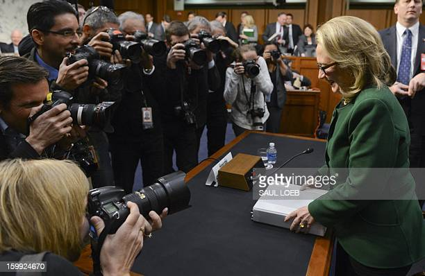 US Secretary of State Hillary Clinton leaves after testifying before the Senate Foreign Relations Committee on the September 11 2012 attack on the US...