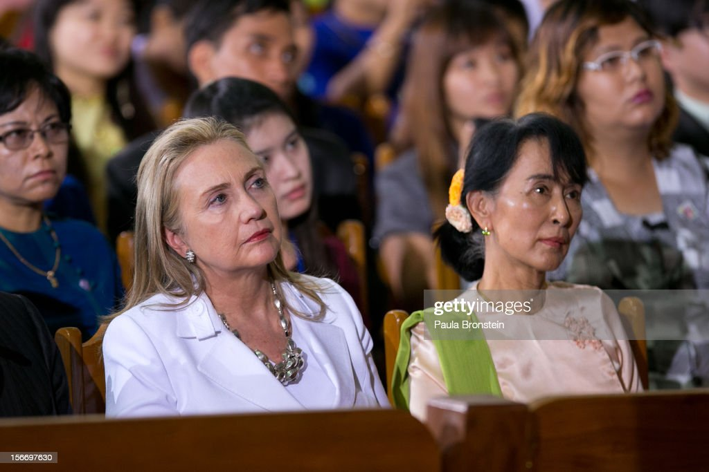US Secretary of State <a gi-track='captionPersonalityLinkClicked' href=/galleries/search?phrase=Hillary+Clinton&family=editorial&specificpeople=76480 ng-click='$event.stopPropagation()'>Hillary Clinton</a> (L) listens alongside <a gi-track='captionPersonalityLinkClicked' href=/galleries/search?phrase=Aung+San+Suu+Kyi&family=editorial&specificpeople=214208 ng-click='$event.stopPropagation()'>Aung San Suu Kyi</a> as US President Barack Obama speaks at the University of Yangon during his historical first visit to the country on November 19, 2012 in Yangon, Myanmar. Obama is the first US President to visit Myanmar while on a four-day tour of Southeast Asia that also includes Thailand and Cambodia.