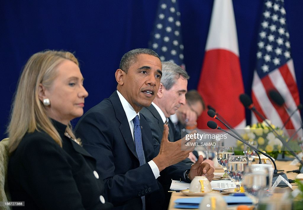 US Secretary of State Hillary Clinton (L) listens as US President Barack Obama (C) speaks during a bilateral meeting with Japan's Prime Minister Yoshihiko Noda (not pictured) on the sidelines of the East Asian Summit at the Peace Palace in Phnom Penh on November 20, 2012. During the two-day East Asia Summit in Phnom Penh, Obama was scheduled to hold talks with the leaders of the 10-member Association of Southeast Asian Nations (ASEAN) along with Chinese Premier Wen Jiabao and Japan's Yoshihiko Noda. AFP PHOTO / Jewel Samad