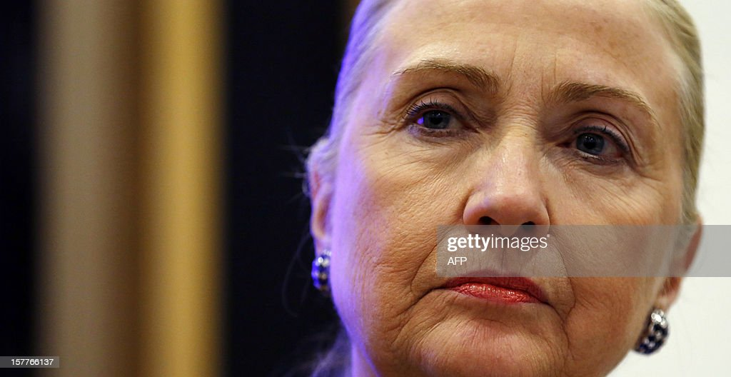 US Secretary of State <a gi-track='captionPersonalityLinkClicked' href=/galleries/search?phrase=Hillary+Clinton&family=editorial&specificpeople=76480 ng-click='$event.stopPropagation()'>Hillary Clinton</a> listens to a question during a joint news conference with Irish Prime Minister Enda Kenny in Government Buildings, Dublin, on December 6, 2012 during the 19th Ministerial Council of the 57-member Organization for Security and Cooperation in Europe (OSCE). Clinton issued a sharp warning to European and central Asian nations that some countries were backsliding on democratic values and human rights.