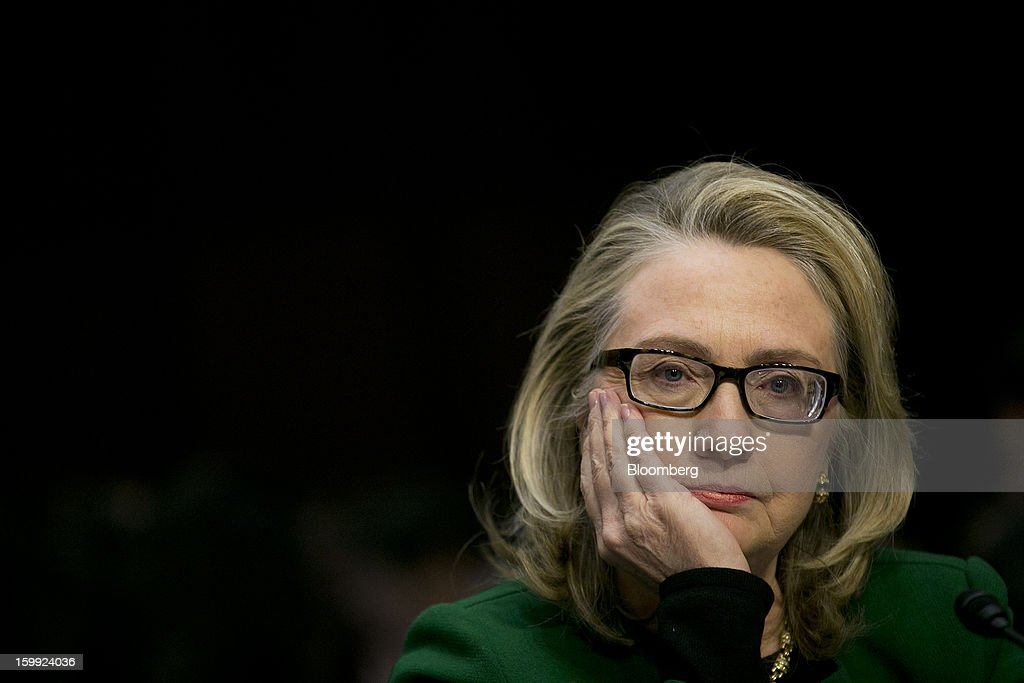 U.S. Secretary of State <a gi-track='captionPersonalityLinkClicked' href=/galleries/search?phrase=Hillary+Clinton&family=editorial&specificpeople=76480 ng-click='$event.stopPropagation()'>Hillary Clinton</a>, listens to a question during a Senate Foreign Relations Committee hearing in Washington, D.C., U.S., on Wednesday, Jan. 23, 2013. Clinton said she is moving quickly to correct the kinds of lapses in diplomatic security that left American diplomats vulnerable in the September attack on the U.S. mission in Benghazi, Libya. Photographer: Andrew Harrer/Bloomberg via Getty Images
