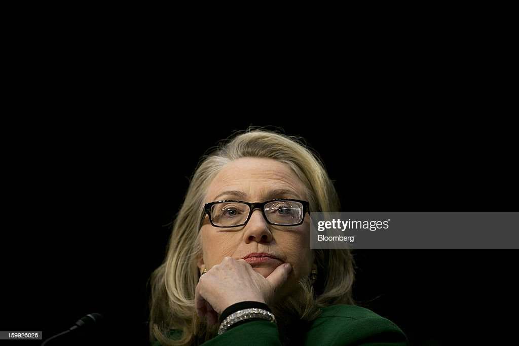 U.S. Secretary of State <a gi-track='captionPersonalityLinkClicked' href=/galleries/search?phrase=Hillary+Clinton&family=editorial&specificpeople=76480 ng-click='$event.stopPropagation()'>Hillary Clinton</a> listens to a question during a Senate Foreign Relations Committee hearing in Washington, D.C., U.S., on Wednesday, Jan. 23, 2013. Clinton said she is moving quickly to correct the kinds of lapses in diplomatic security that left American diplomats vulnerable in the September attack on the U.S. mission in Benghazi, Libya. Photographer: Andrew Harrer/Bloomberg via Getty Images
