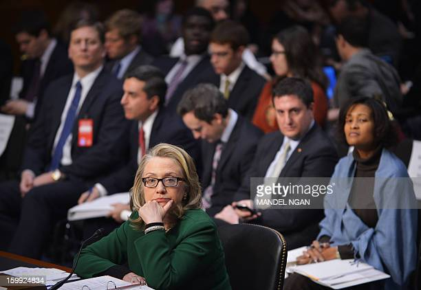 US Secretary of State Hillary Clinton listens to a statment as she testifies before the Senate Foreign Relations Committee on the September 11 2012...