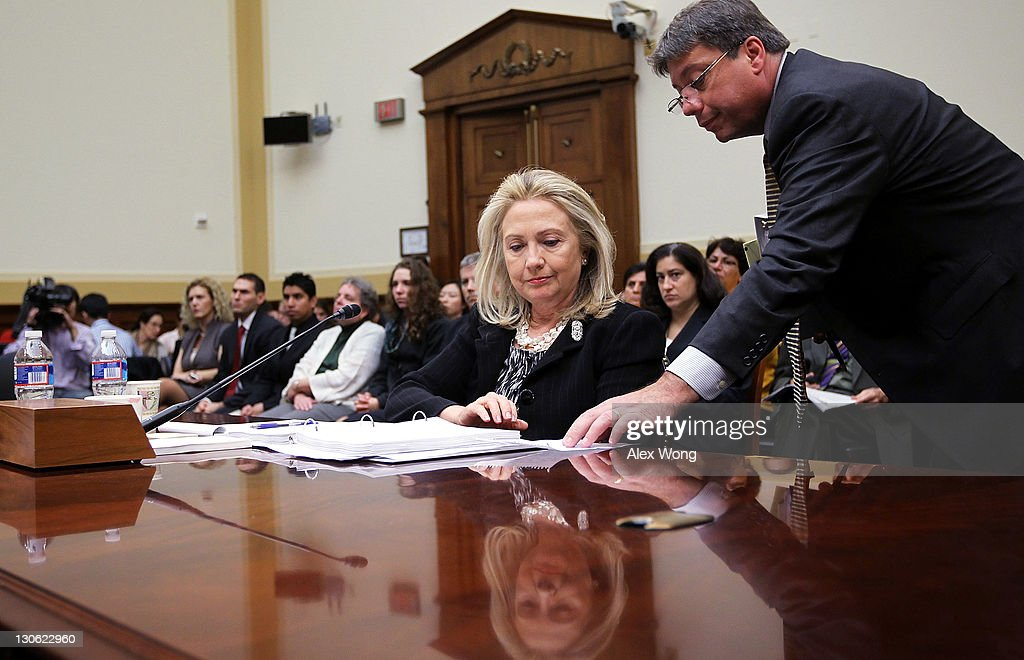 U.S. Secretary of State <a gi-track='captionPersonalityLinkClicked' href=/galleries/search?phrase=Hillary+Clinton&family=editorial&specificpeople=76480 ng-click='$event.stopPropagation()'>Hillary Clinton</a> (L) listens to an aide during a hearing before the House Foreign Affairs Committee October 27, 2011 on Capitol Hill in Washington, DC. Clinton testified on 'Afghanistan and Pakistan: Transition and the Way Forward.'