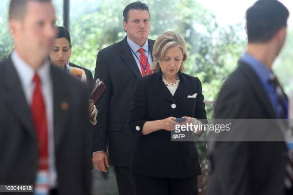 US secretary of state Hillary Clinton looks at her mobile phone after attending a Russia US meeting on the sidelines of the 43rd annual Association...