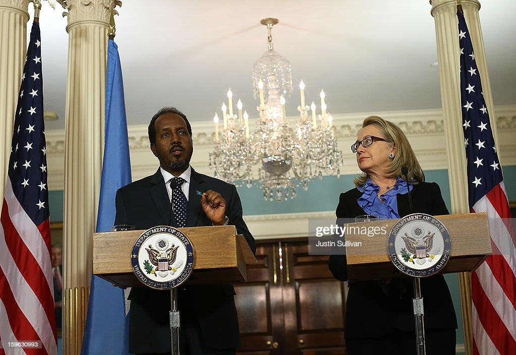 Secretary of State <a gi-track='captionPersonalityLinkClicked' href=/galleries/search?phrase=Hillary+Clinton&family=editorial&specificpeople=76480 ng-click='$event.stopPropagation()'>Hillary Clinton</a> (R) looks on as Somali president Hassan Sheikh Mohamud speaks during a news conference on January 17, 2013 in Washington, DC. Secretary Clinton announced that the United States would recognize the Somali government for the first time in over 20 years, since the shooting down in Mogadishu of two American Black Hawk helicopters.