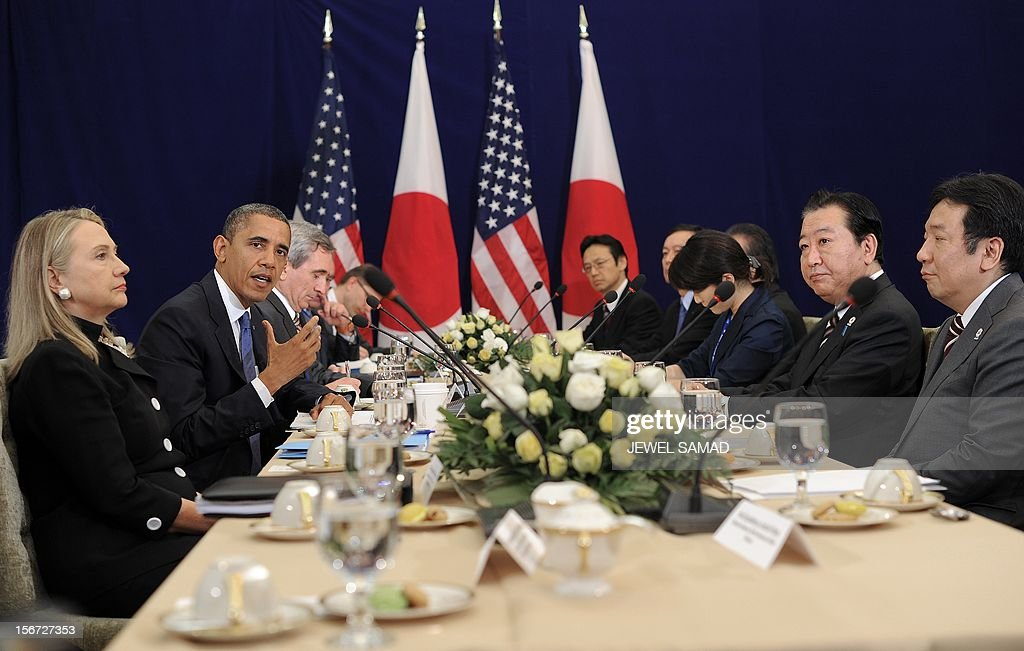 US Secretary of State Hillary Clinton (L) looks on as US President Barack Obama (2nd L) speaks during a bilateral meeting with Japanese Prime Minister Yoshihiko Noda (2nd R) on the sidelines of the East Asian Summit at the Peace Palace in Phnom Penh on November 20, 2012. During the two-day East Asia Summit in Phnom Penh, Obama was scheduled to hold talks with the leaders of the 10-member Association of Southeast Asian Nations (ASEAN) along with Chinese Premier Wen Jiabao and Japan's Yoshihiko Noda. AFP PHOTO / Jewel Samad