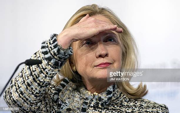 US Secretary of State Hillary Clinton looks up during a press conference at the 48th Munich Security Conference in Munich southern Germany on...