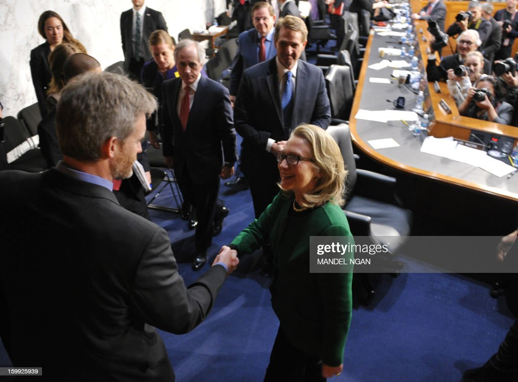 US Secretary of State Hillary Clinton makes her way from the room after testifying before the Senate Foreign Relations Committee on the September 11, 2012 attack on the US mission in Benghazi, Libya in the Hart Senate Office Building on January 23, 2013 in Washington, DC. AFP PHOTO/Mandel NGAN