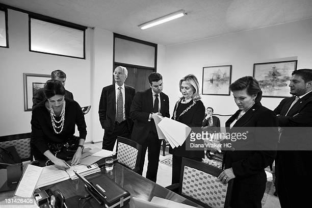 Secretary of State Hillary Clinton meeting with staff between events at the foreign ministry is photographed for Time Magazine on October 21 2011 in...