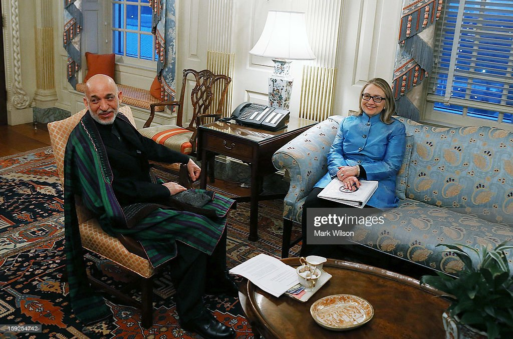 U.S. Secretary of State <a gi-track='captionPersonalityLinkClicked' href=/galleries/search?phrase=Hillary+Clinton&family=editorial&specificpeople=76480 ng-click='$event.stopPropagation()'>Hillary Clinton</a> (R) meets with Afghan President <a gi-track='captionPersonalityLinkClicked' href=/galleries/search?phrase=Hamid+Karzai&family=editorial&specificpeople=121540 ng-click='$event.stopPropagation()'>Hamid Karzai</a> at the State Department January 10, 2013 in Washington, DC. Karzai is on a visit in Washington, including a meeting with U.S. President Barack Obama at the White House, to discuss the continued transition in Afghanistan and the partnership between the two nations.