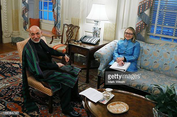 S Secretary of State Hillary Clinton meets with Afghan President Hamid Karzai at the State Department January 10 2013 in Washington DC Karzai is on a...