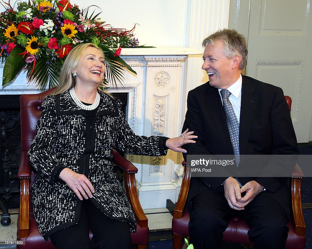 US Secretary of State <a gi-track='captionPersonalityLinkClicked' href=/galleries/search?phrase=Hillary+Clinton&family=editorial&specificpeople=76480 ng-click='$event.stopPropagation()'>Hillary Clinton</a> (L) meets with First Minister <a gi-track='captionPersonalityLinkClicked' href=/galleries/search?phrase=Peter+Robinson+-+Politician&family=editorial&specificpeople=4762110 ng-click='$event.stopPropagation()'>Peter Robinson</a> at Stormont Castle on December 7, 2012 in Belfast, United Kingdom. Clinton visists Belfast as part of a four-day European tour. She called for a renewed commitment to peace in the region from political parties.
