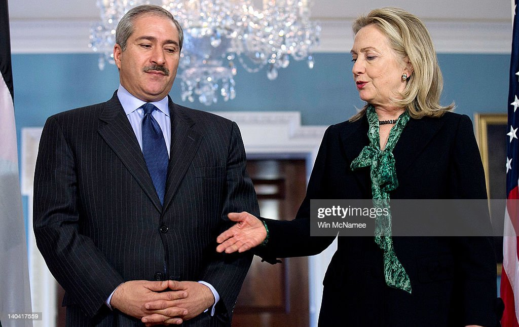 U.S. Secretary of State Hillary Clinton (R) offers her hand while greeting Jordanian Foreign Minister Nasser Judeh (L) at the State Department March 2, 2012 in Washington, DC. The two were scheduled to hold a bilateral meeting following their remarks.