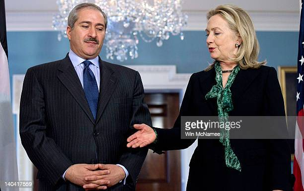 S Secretary of State Hillary Clinton offers her hand while greeting Jordanian Foreign Minister Nasser Judeh at the State Department March 2 2012 in...