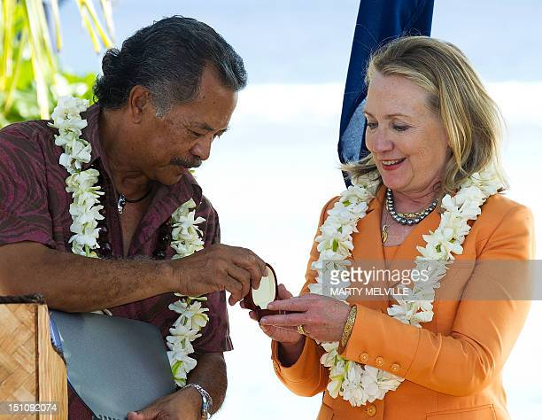 US Secretary of State Hillary Clinton receives a gift from Cook Islands Prime Minister Henry Puna during an event on peace and security as part of...
